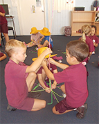 students building with straws